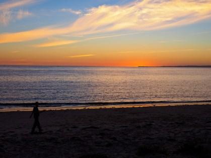 Nic strolls on the sunset beach.