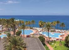 View of the hotel pools and sea from the hotel balcony in Tenerife