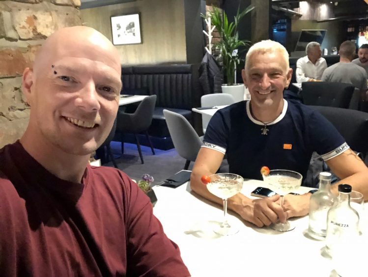 Husbands dining out for an anniversary meal