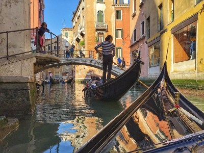 Gondola and the driver in Venice