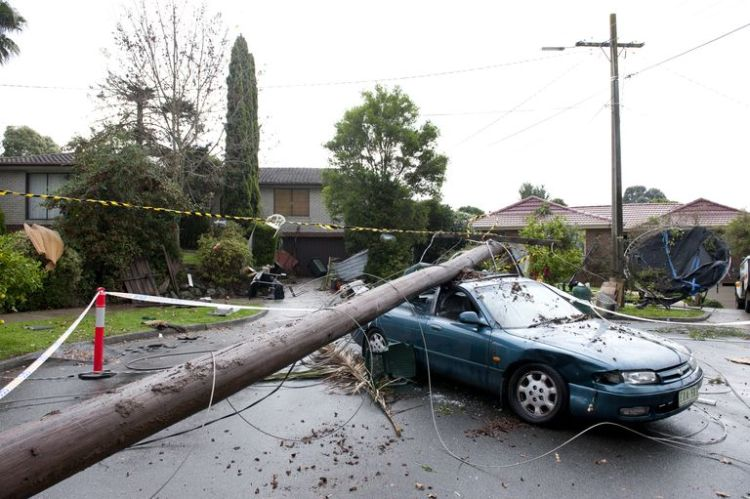 Neighbours' Ramsay Street tornado aftermath. Power poles crashed on a car