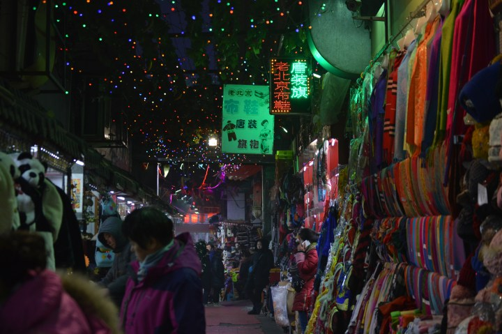 Shopping at a night market in Hong Kong