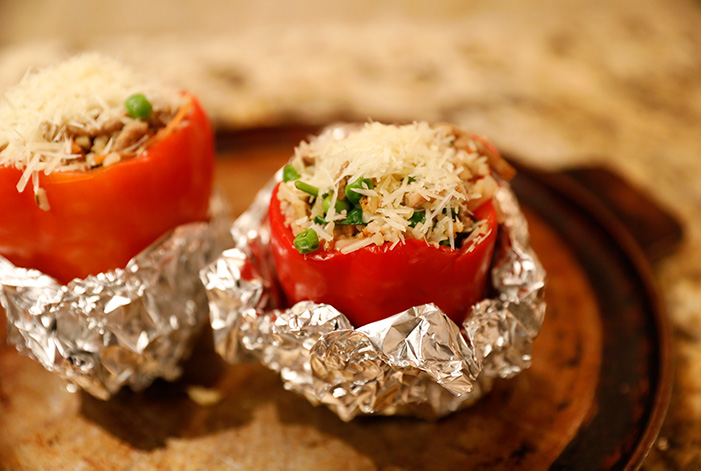 One way to keep your stuffed bell peppers upright is some aluminum foil