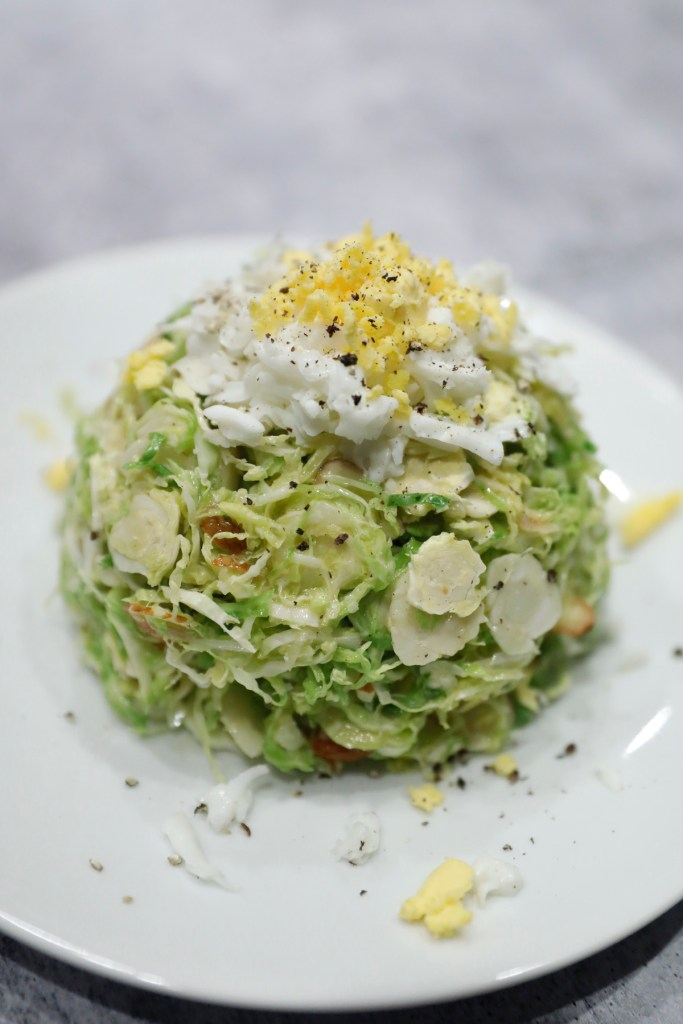 Shaved brussel sprout salad, inspired from a meal during a trip.