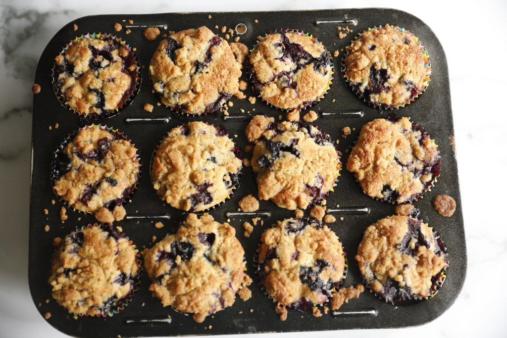 Amazing blueberry muffins with crumble are ready to be shared with family and friends.