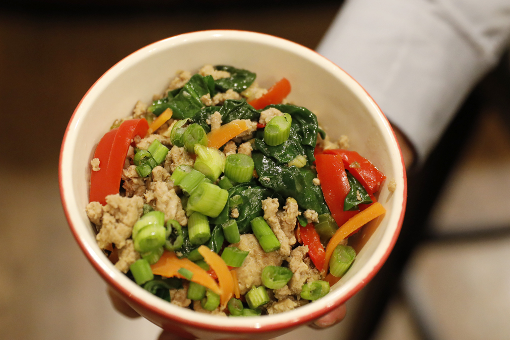 For the final touches on Asian Turkey bowl, serve over brown rice, top with scallions, serve with a quartered lime.
