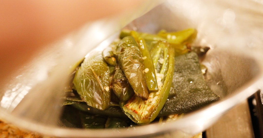 After roasting peppers you can steam them in a bowl under saran wrap to make removing waxy layer more easily.