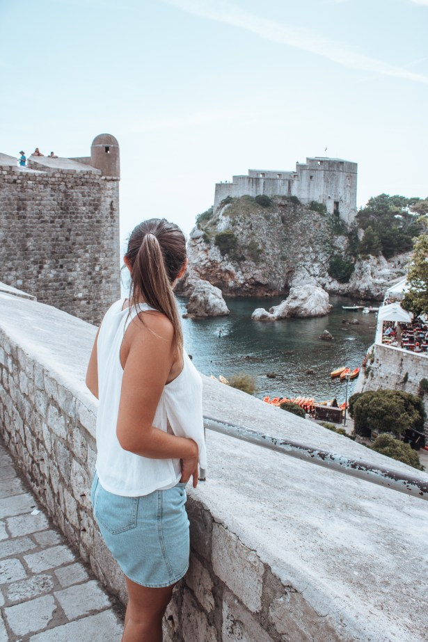 girl standing looking at view of fort