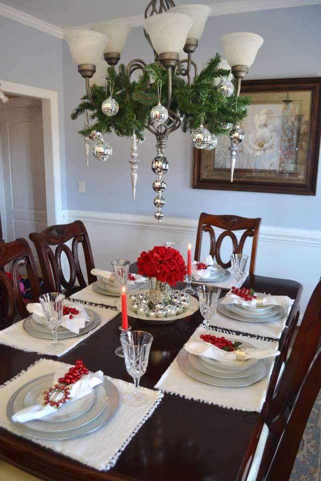 I love the garland and ornaments hanging from the light fixture in this beautiful Silver and Red Christmas Tablescape!