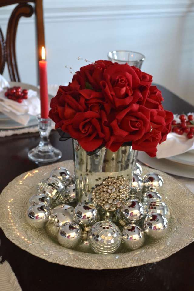 Beautiful Christmas Centerpiece with Silver glass ball ornaments and a bouquet of red roses