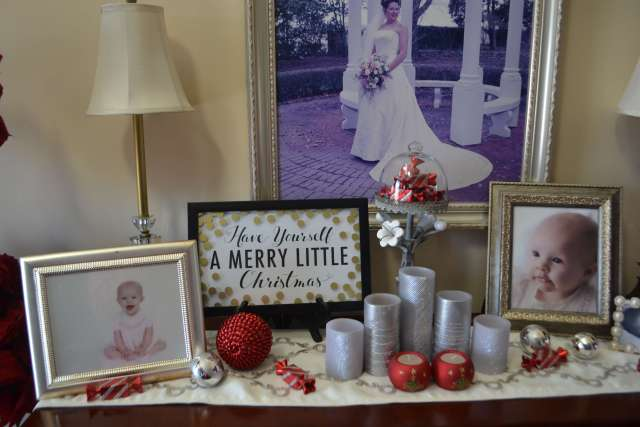 I love the Christmas Decor and touches of red on this buffet table decorated for Christmas!