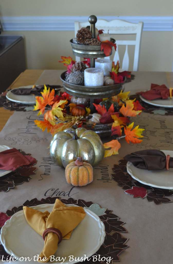 Love this beautiful table set for fall! Great use for Kraft Paper and hand-lettering with a styled three tier tray