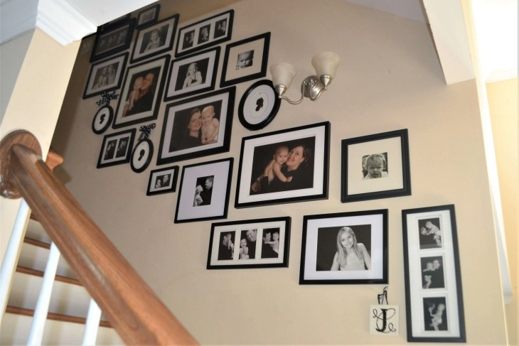 Love this stairs gallery wall! No measuring tape or craft paper required! #gallerywall