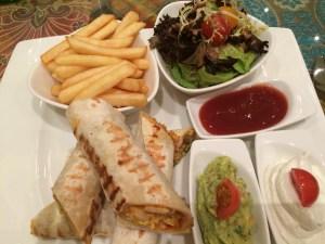 Quesilladilla - stye wrap with guacamole and sour cream