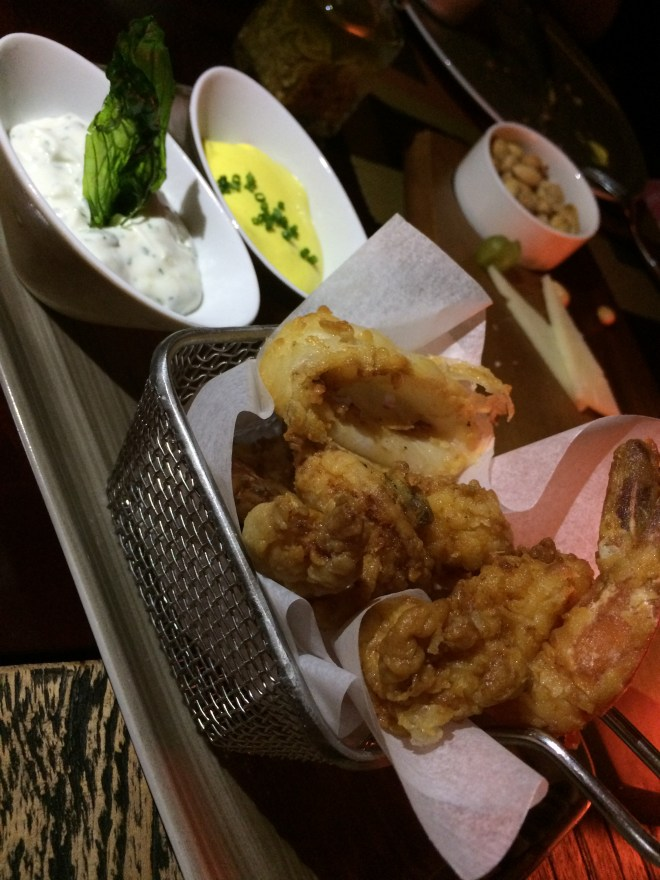 Fried seafood with saffron sauce