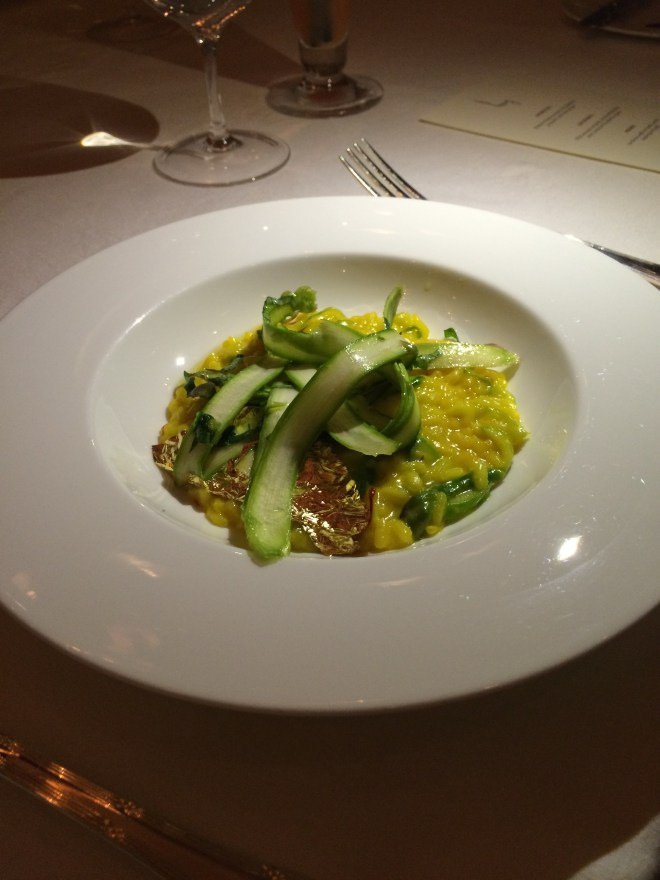Saffron risotto with asparagus and gold leaf.