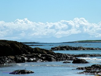 Rock Pools and Distant Mountains