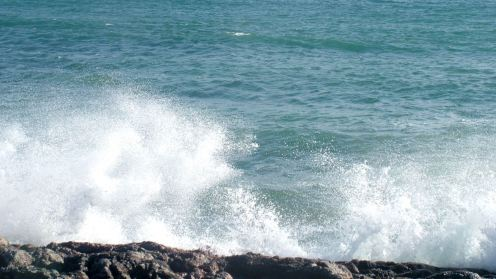 The swell breaking on the rocky foreshore