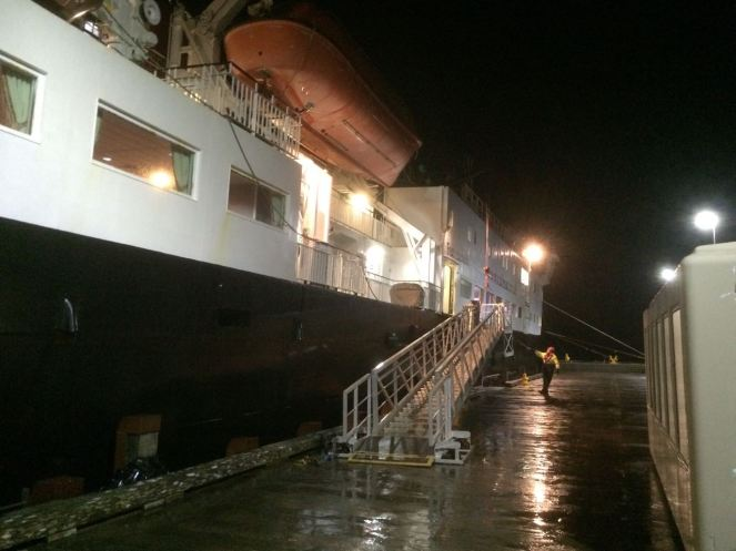 Foot passengers on board the gangway is lowered and lashed.