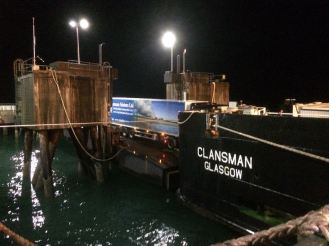 Local haulier's lorry mounts the stern ramp bound for Oban