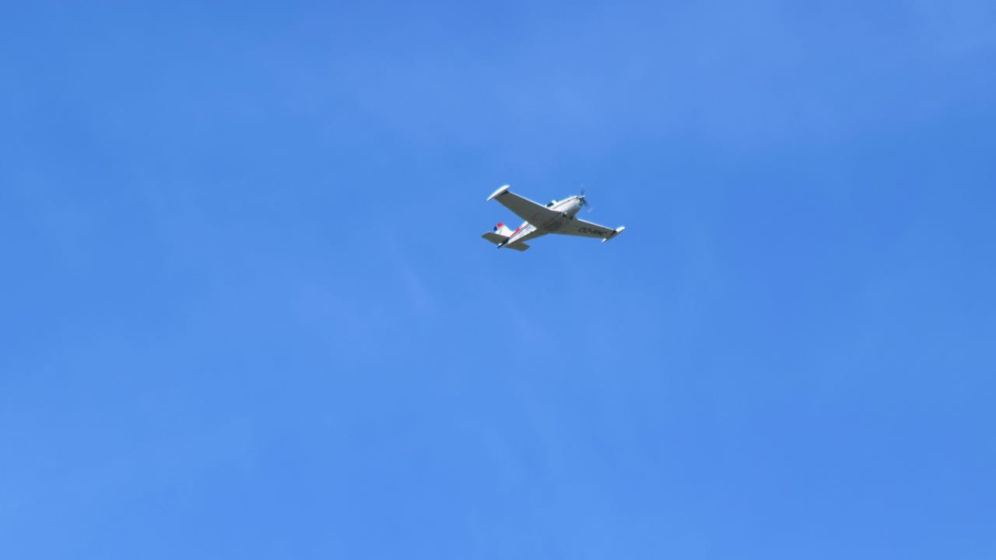 Light aircraft in blue skies