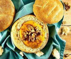 Bread Bowl filled with Butternut Squash soup topped with maple candied walnuts.