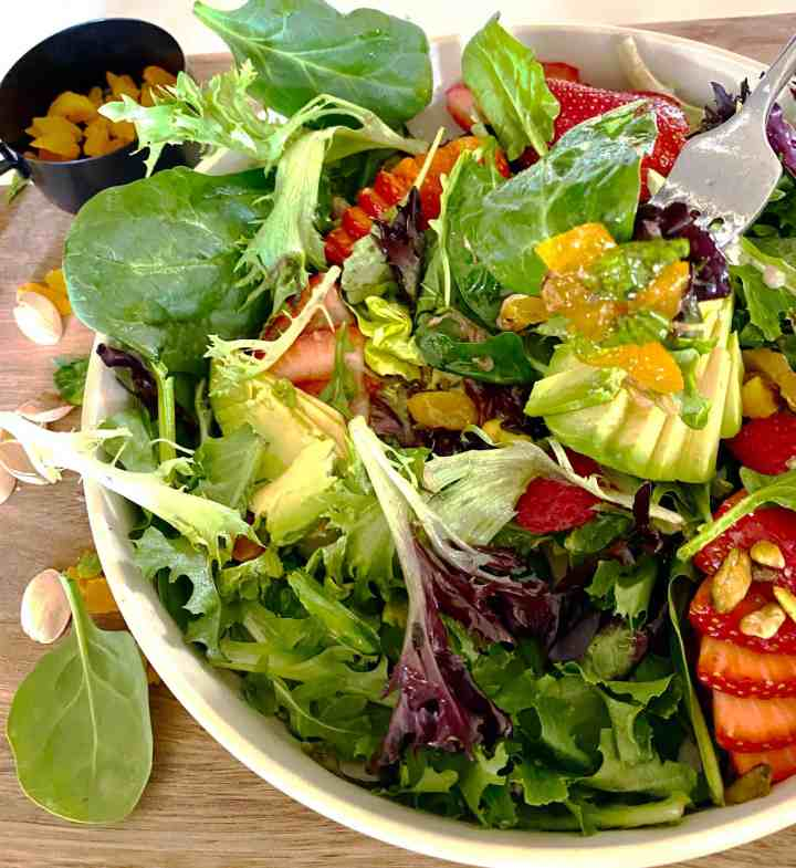 Spring Salad Mix Recipe salad with a fork loaded with apricot and avocado