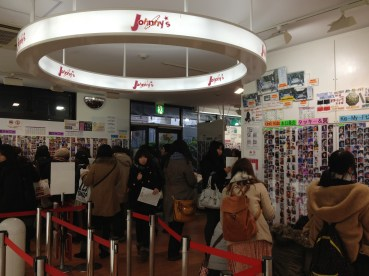 A very crowded shop that only sells photos of Japanese pop stars