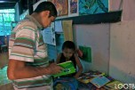 Jonathon reading the Giving Tree to a student at The Peace Project in Laguna de Apoyo, Nicaragua