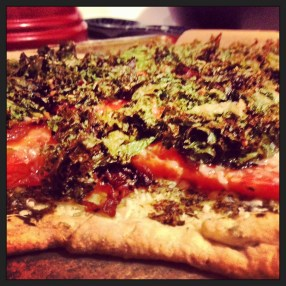 I made this savory piece of heaven with ingredients already sitting around in my fridge: leftover pie crust, dandelion pest, caramelized onions, kale, tomatoes, parmesan. Inspired by Bonnie Azab Powell. Eaten by me.
