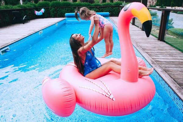 Mother & daughter enjoying the pool on a floatie