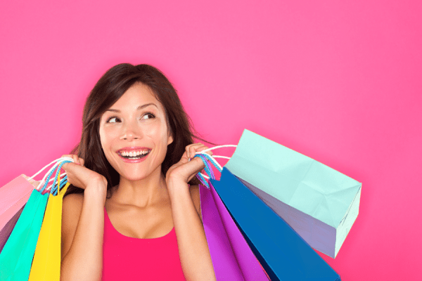 Woman enjoying shopping spree with shopping bags using IBotta