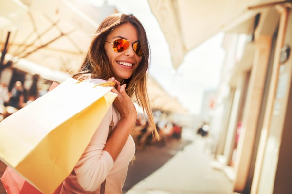 Woman using Ibotta to save on summer shopping sales