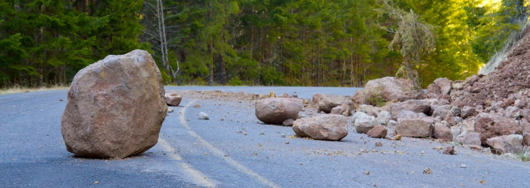 boulders blocking roadway