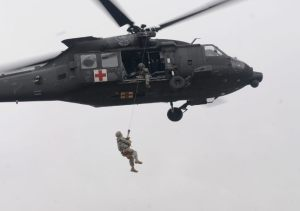 US Army Helicopter Hoisting a Soldier