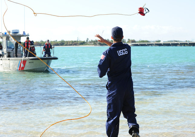 USCG MST throws line to vessel.