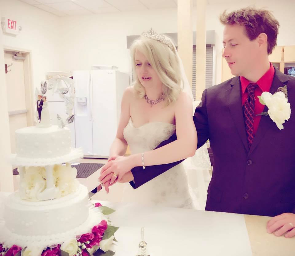 Cutting our wedding cake!