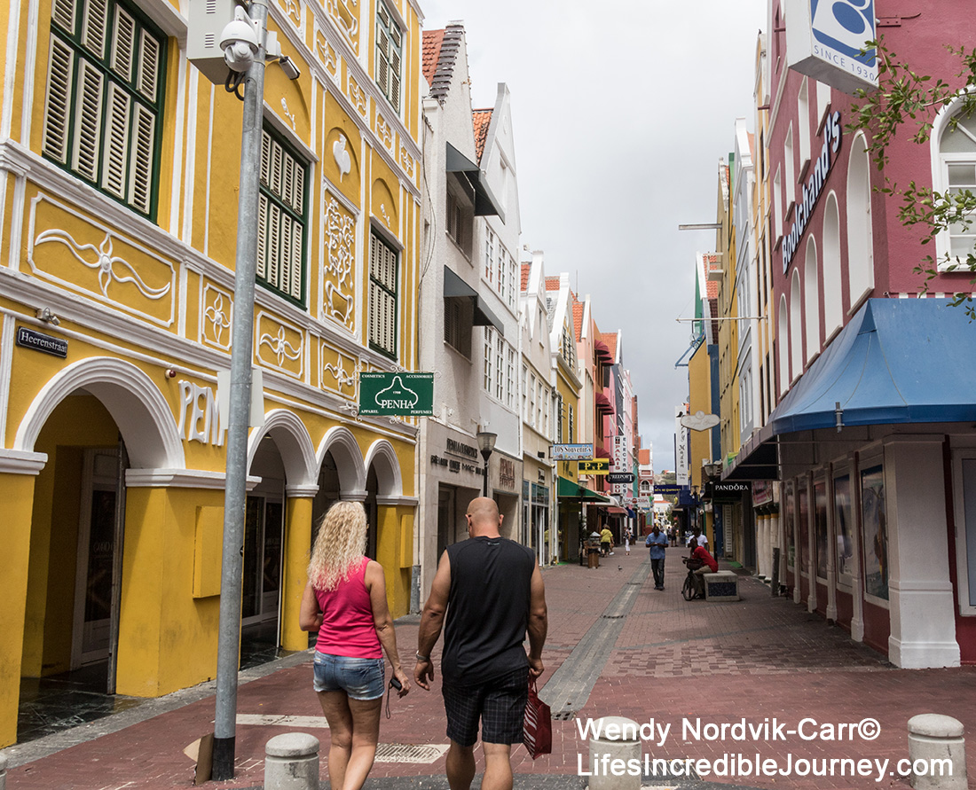 Colourful streets of UNESCO World Heritage Site of Willemstad on the Caribbean Island of Curaçao. The waterfront market at the UNESCO World Heritage Site of Willemstad on the Caribbean Island of Curaçao. Photo Credit: Wendy Nordvik-Carr