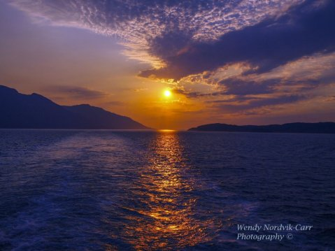 One of the top things to do on Alaskan cruise is to enjoy a spectacular sunset. Sunsets in Alaska brilliantly reflect off the ocean waters of the Inside Passage. Photo Credit: Wendy Nordvik-Carr