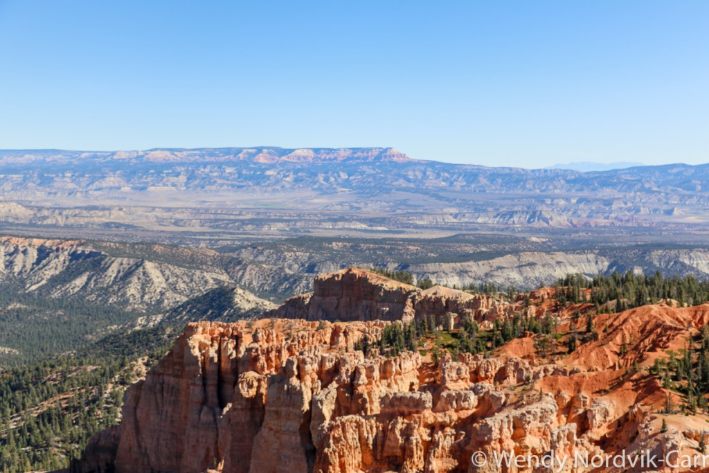 Travel to Bryce Canyon to discover The largest hoodoo collection in the world. The stop at at Mile 18 provides some of the longest continuous views available in North America. This viewpoint provides access to the Bristlecone Loop trail.