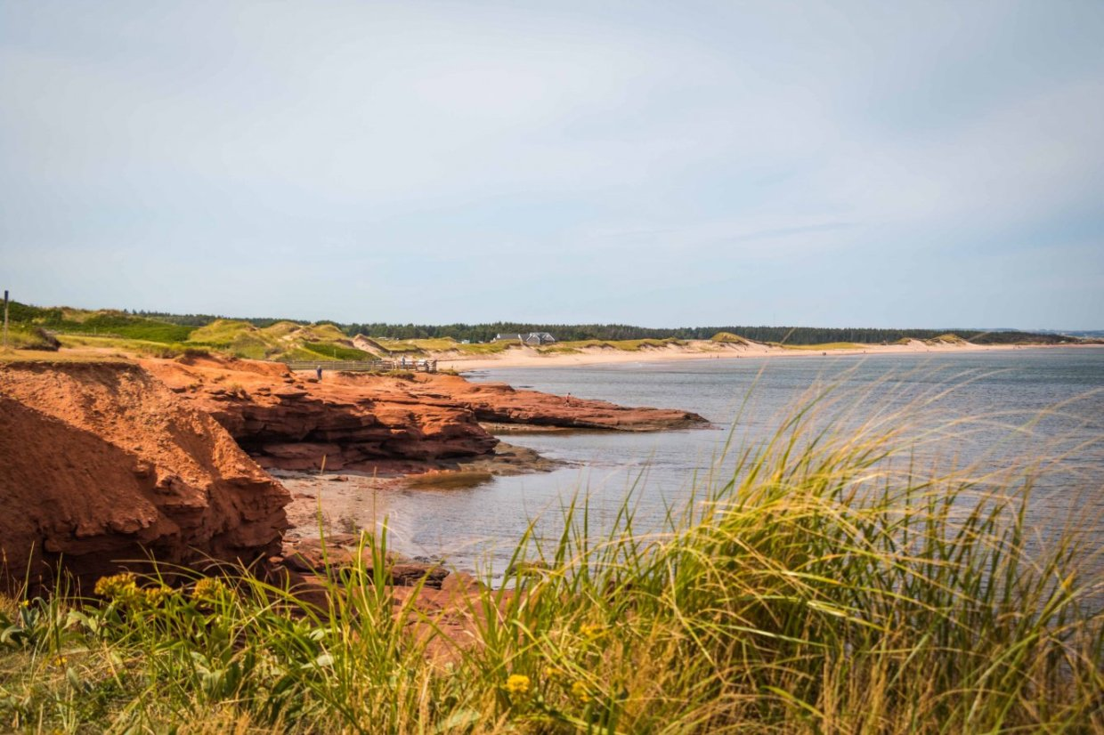 The scenic PEI Green Gable Shore drive gives you access to stunninåg Cavendish seascape views of red sandstone cliffs and pristine white sandy beaches. Photo Credit: Wendy Nordvik-Carr
