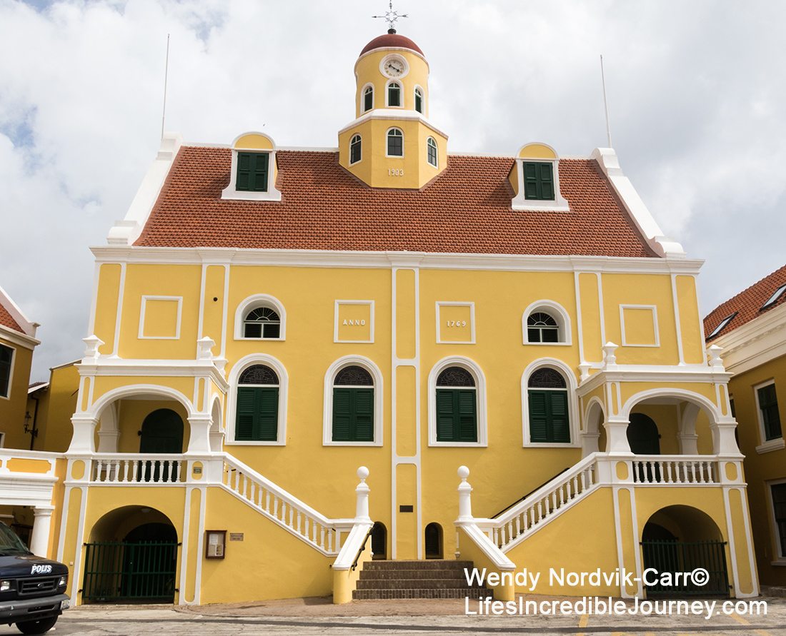 Fort Amsterdam UNESCO World Heritage Site of Willemstad on the Caribbean Island of Curaçao. The waterfront market at the UNESCO World Heritage Site of Willemstad on the Caribbean Island of Curaçao. Photo Credit: Wendy Nordvik-Carr