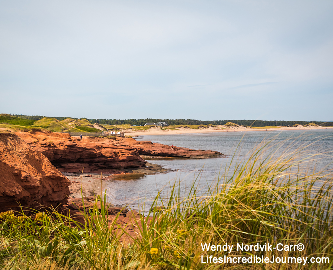 The scenic PEI Green Gable Shore drive gives you access to stunning Cavendish seascape views of red sandstone cliffs and pristine white sandy beaches.