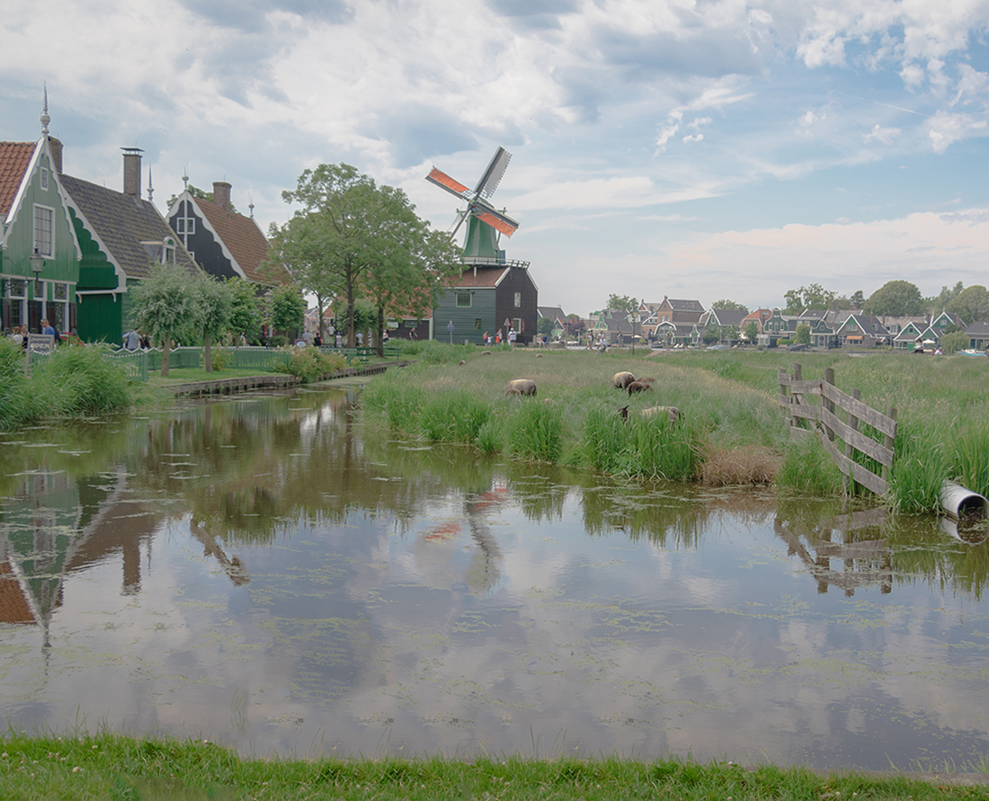 View a collection of windmills and learn about Dutch history at Zaanse Schans in the beautiful countryside of Holland, near Amsterdam. Photo Credit: Wendy Nordvik-Carr