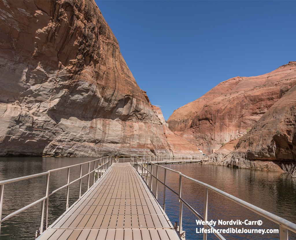 Explore sacred Rainbow Bridge National Monument, Utah, near Lake Powell, Arizona. It is the tallest natural bridge in North America. Access this world wonder by taking a two hour boat ride through spectacular scenery of Lake Powell and Glen Canyon National Recreation Area. Photo Credit: Wendy Nordvik-Carr©