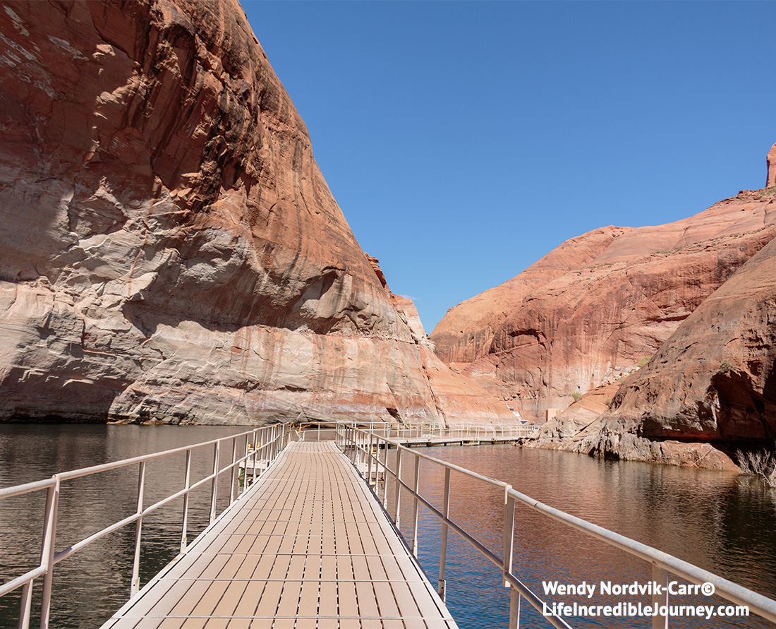 Travel Utah - Travel Arizona - Don't miss the top things to do at Lake Powell. These unforgettable adventures at Lake Powell will not leave you disappointed. Lake Powell is a massive, adventure playground with breathtaking scenery. Explore the incredible area of Glen Canyon and Lake Powell. Photo Credit Wendy Nordvik-Carr©