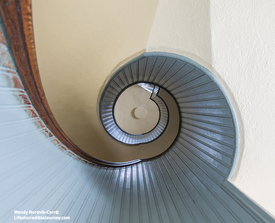 The spiral staircase inside historic Point Loma Lighthouse the oldest lighthouse on the Pacific coast. Photo Credit: Wendy Nordvik-Carr©