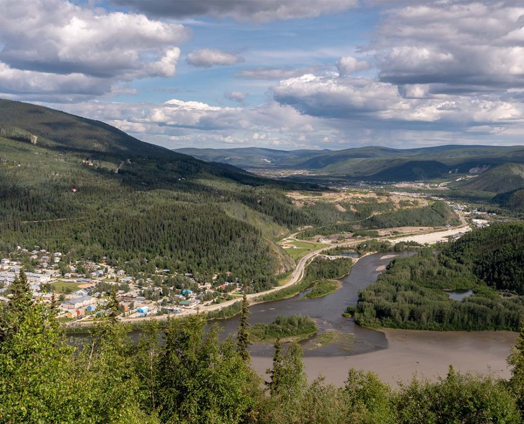 Top of the World Highway is an iconic scenic drive in the Yukon. This is the view of Dawson City and the Klondike and Yukon River.