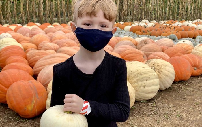 E picks his favourite pumpkin at the Pumpkin Patch at Taves Family Farms. Photo: Wendy Nordvik-Carr©