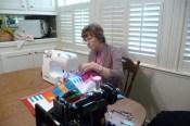 Carol stitching the rows